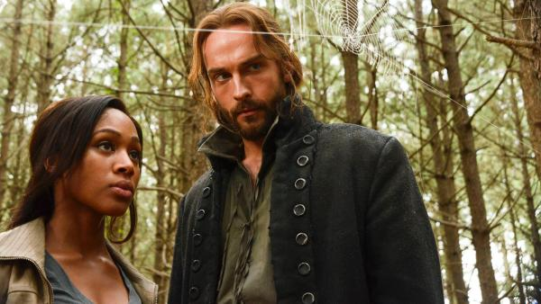 Lt. Abbie Mills (Nicole Beharie, R) and Ichabod Crane (Tom Mison, L) search for Abbies estranged sister in The Lesser Key of Solomon episode of Sleepy Hollow, airing on Monday, Oct. 7 on FOX. - Provided courtesy of Brownine Harris / FOX