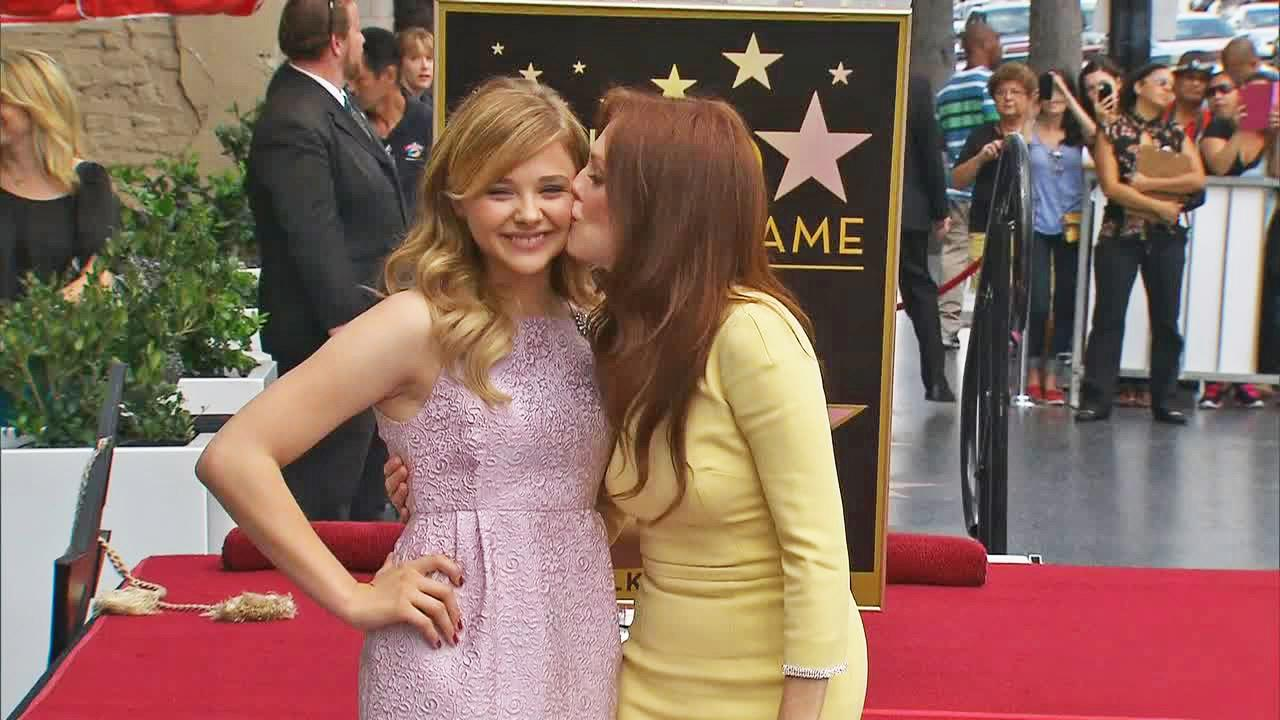 Chloe Grace Moretz and Julianne Moore appear at Moores star ceremony at the Hollywood Walk of Fame on Oct. 3, 2013.