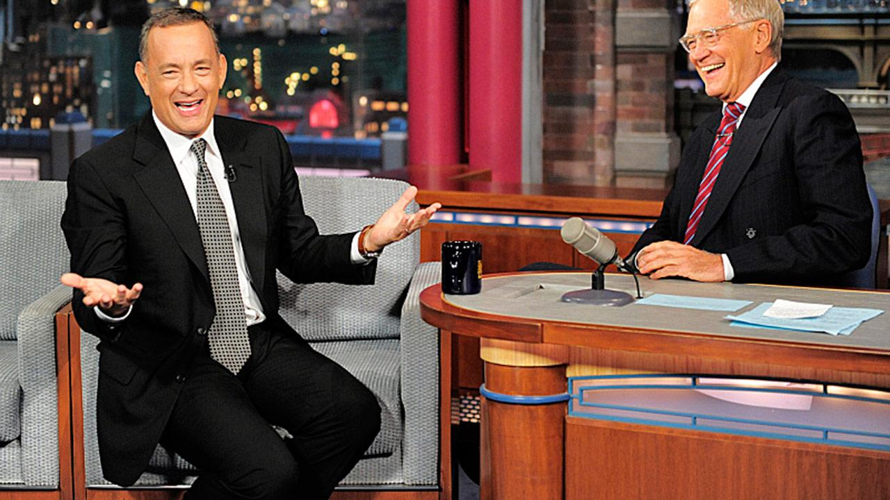 Tom Hanks chats with David Letterman on The Late Show with David Letterman on Oct. 7, 2013.