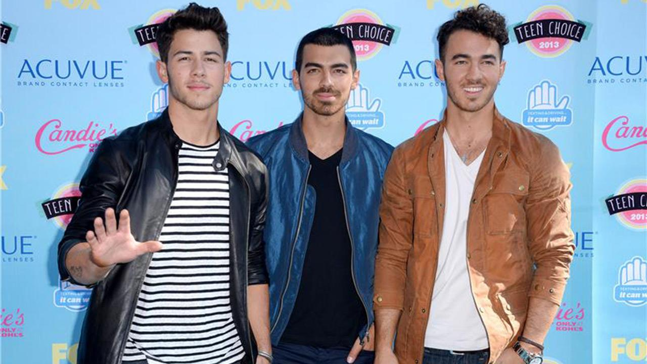 Nick Jonas, Joe Jonas and Kevin Jonas (The Jonas Brothers) appear at the 2013 Teen Choice Awards at the Gibson Amphitheatre in Universal City, near Los Angeles, on Aug. 11, 2013.