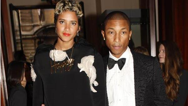 Pharrell Williams and Helen Lasichanh appear at the 2013 GQ Men of the Year Awards in London on Sept. 3, 2013.