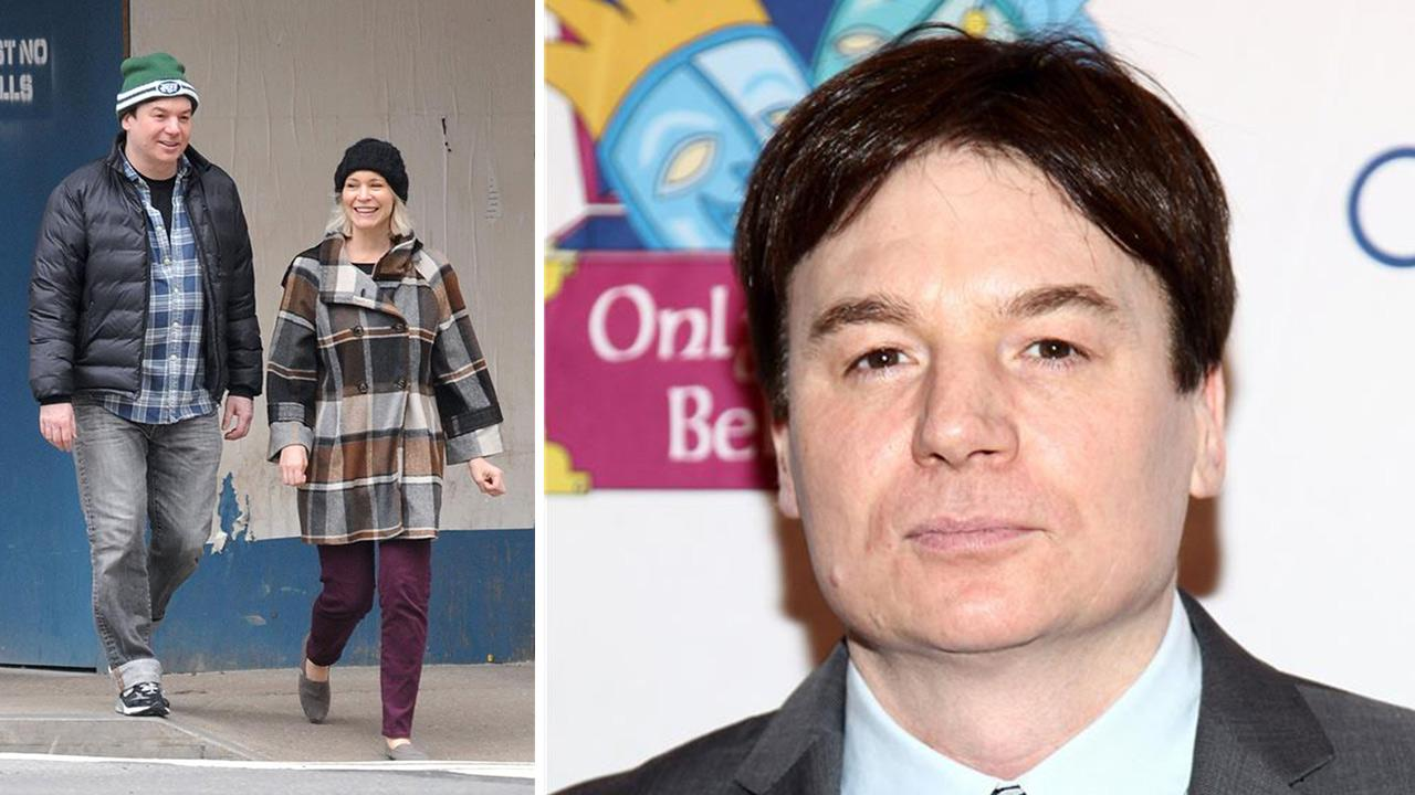 Mike Myers and his wife, Kelly Tisdale, walk on a street in New York on Nov. 2, 2012. / Mike Myers appears at the 12th annual gala and performance of the play Make Believe on Broadway in New York on Nov. 14, 2011.Ken Katz / Sara Jaye Weiss / Startraksphoto.com