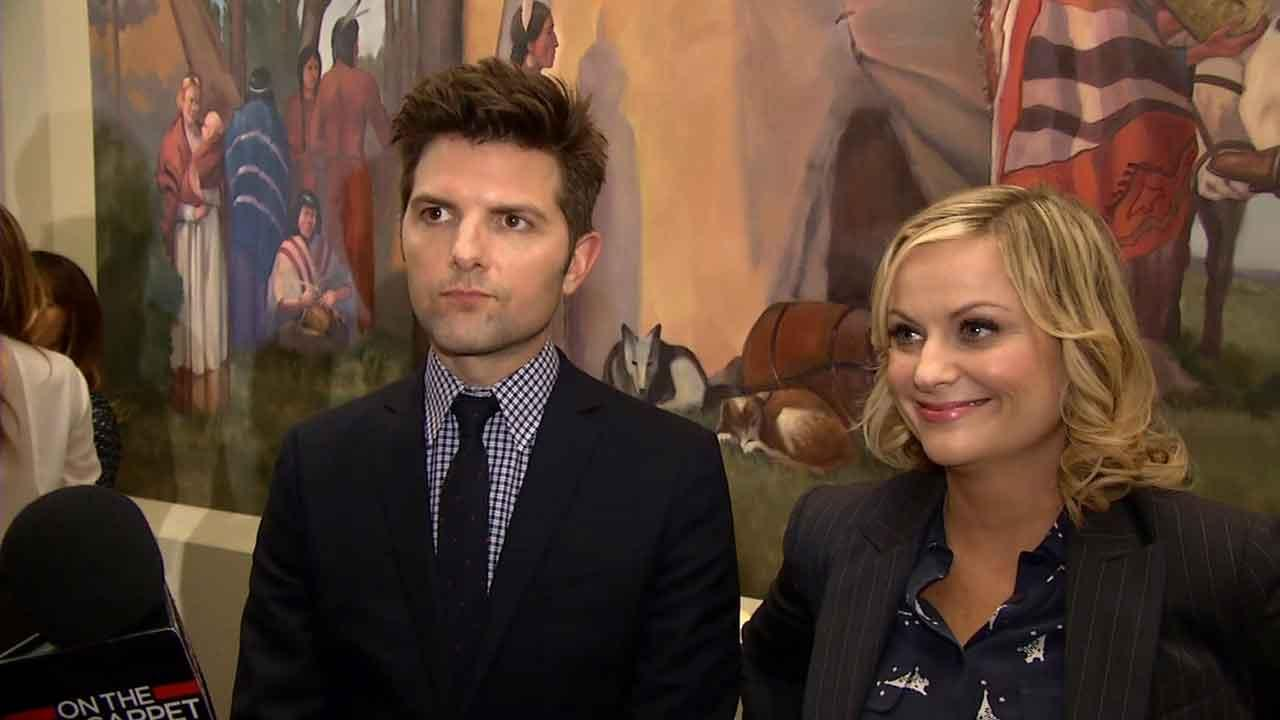 Adam Scott and Amy Poehler appear at the 100th episode party for Parks and Recreation on Oct. 16, 2013.