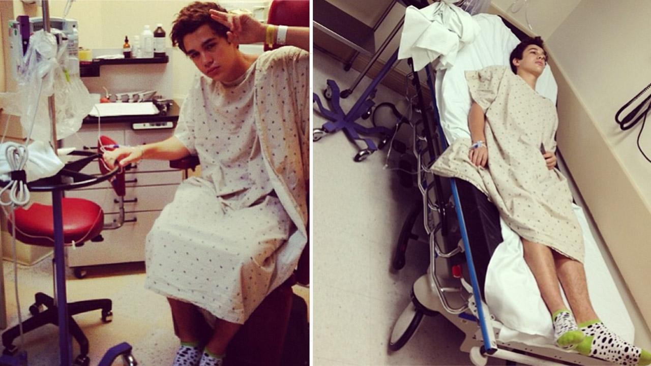 Austin Mahone is seen on a hospital bed in these Instagram photos he and his mother Michele shared on Oct. 17, 2013. He was hospitalized with flu symptoms.