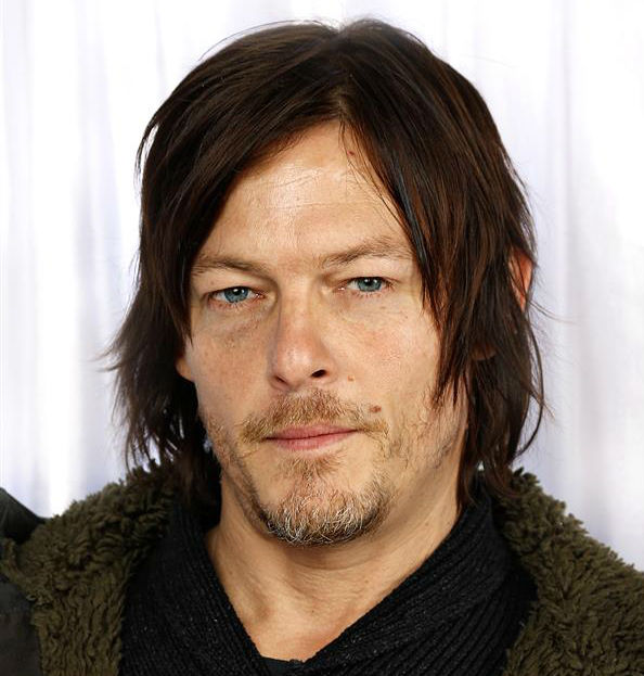Norman Reedus, who plays Daryl Dixon on AMC&#39;s &#39;The Walking Dead,&#39; poses in a holiday-themed photo booth at Z100&#39;s Jingle Ball 2013 on Dec. 13, 2013, just before Christmas. <span class=meta>(Sara Jaye Weiss  &#47; Startraksphoto.com)</span>