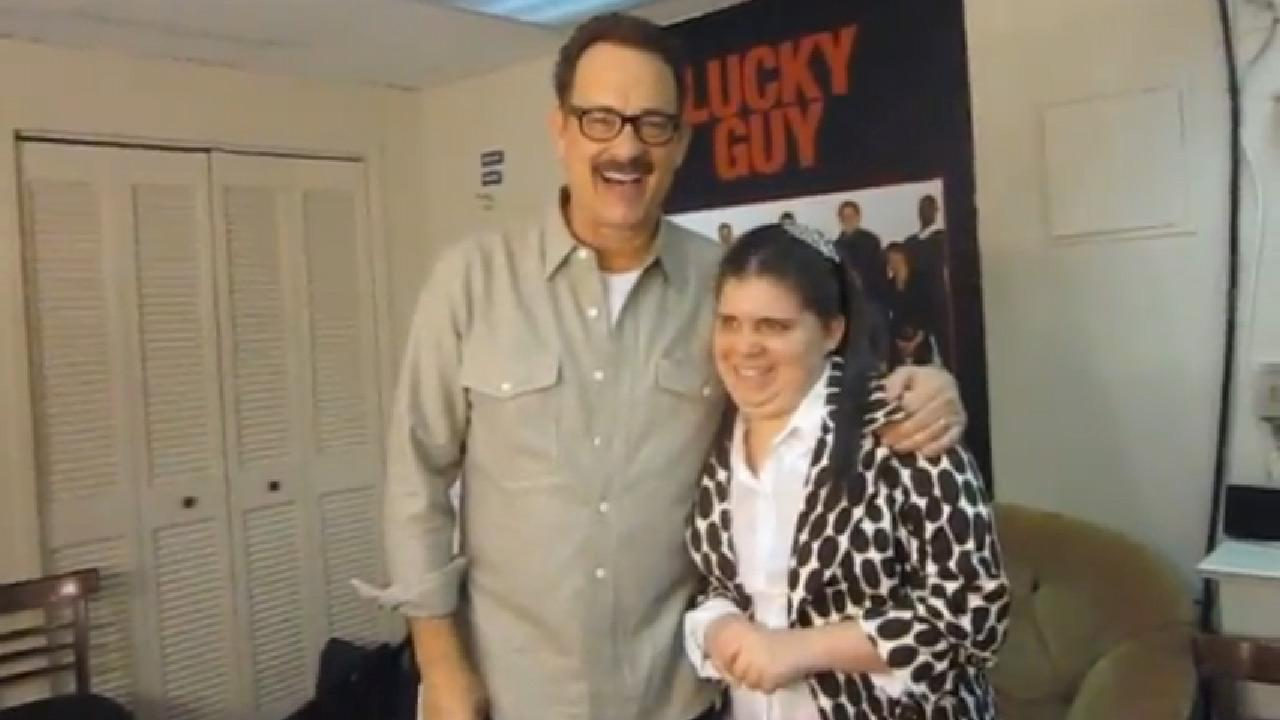 Tom Hanks is seen greeting fan Sarah Moretti backstage of his Broaway show Lucky Guy in March 2013.