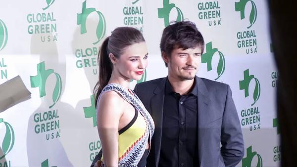 Victoria's Secret supermodel Miranda Kerr and husband Orlando Bloom appear at the 2013 Global Green USA pre-Oscars party at the Avalon club in Hollywood, California on Feb. 20, 2013.