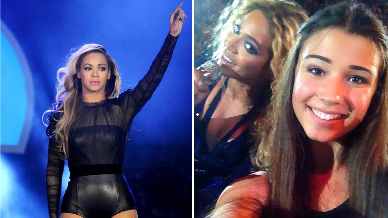 Beyonce appears at the 2013 Chime For Change: The Sound Of Change Live Concert at Twickenham Stadium on June 6, 2013. / The singer appears with a fan at a concert in Australia on Oct. 25, 2013.