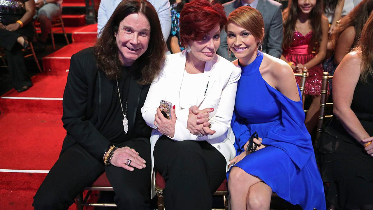 Dancing With The Stars competitor Jack Osbournes parents, rocker Ozzy Osbourne and Sharon Osbourne, and wife Lisa Stelly sit in the studio audience during a live taping of the season 17 debut of the ABC dance show in Los Angeles on Sept. 16, 2013.ABC Photo / Adam Taylor