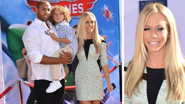 Kendra Wilkinson, husband Hank Baskett and son Hank IV appear at the Los Angeles premiere of Disney's 'Planes' on Aug. 5, 2013.