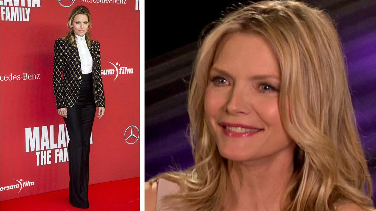 Michelle Pfeiffer appears at the premiere of The Family in Berlin, Germany on Oct. 15, 2013. / Michelle Pfeiffer talks to OTRC.com about the movie People Like Us in June 2012.
