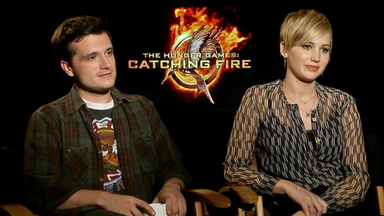Jennifer Lawrence and Josh Hutcherson appear in an interview with OTRC.com on Nov. 7, 2013.