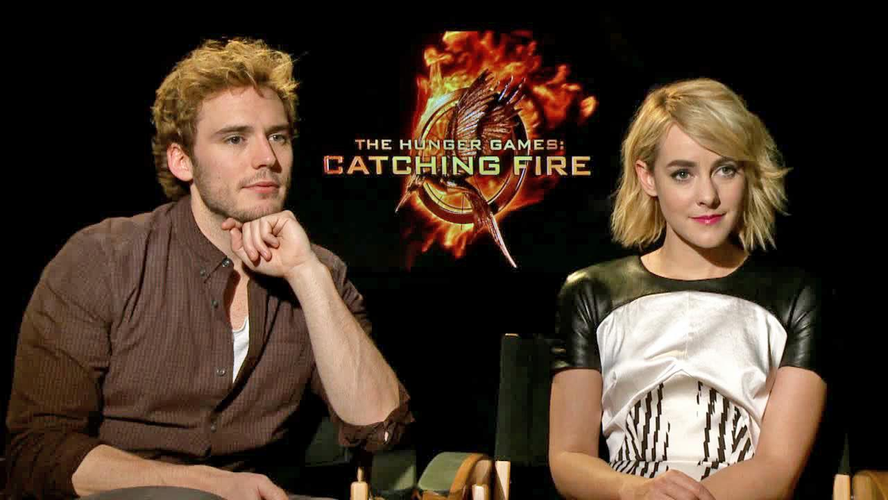 Sam Claflin and Jena Malone appear in an interview with OTRC.com on Nov. 7, 2013.