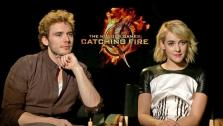 Sam Claflin and Jena Malone appear in an interview with OTRC.com on Nov. 7, 2013. - Provided courtesy of OTRC