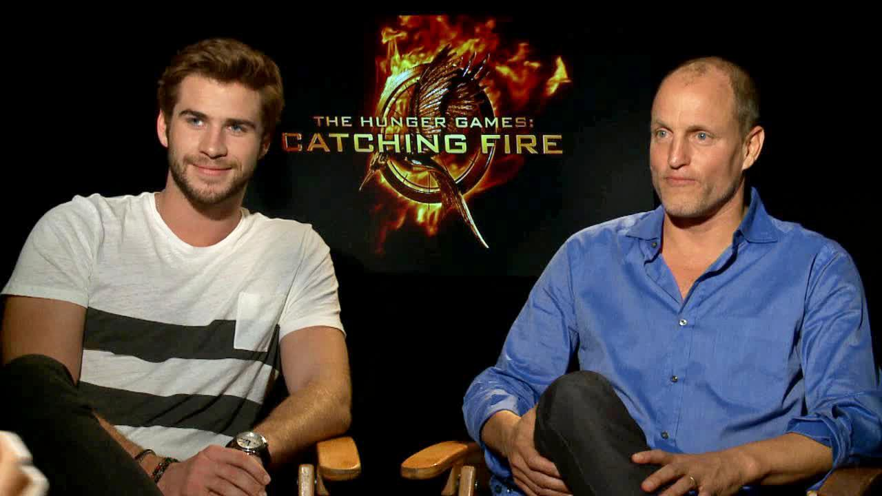 Liam Hemsworth and Woody Harrelson appear in an interview with OTRC.com on Nov. 7, 2013.