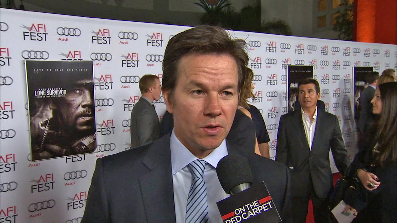 Mark Wahlberg talks to OTRC.com about his new reality show, Wahlburgers, at the premiere of the movie Lone Survivor at 2013 AFI Fest in Los Angeles on Nov. 12, 2013.
