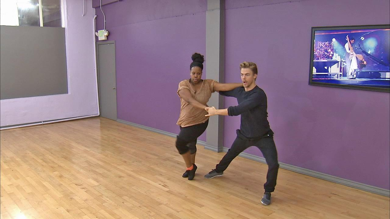 Amber Riley and Derek Hough dance at a rehearsal before the Dancing With The Stars season 17 finale. (November 2013)