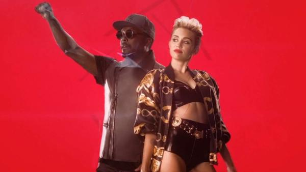 Miley Cyrus and will.i.am appear in the music video for the 2013 song Feelin Myself. - Provided courtesy of Interscope Records