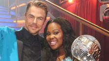 Amber Riley and Derek Hough appear in a still from Dancing With The Stars on Nov. 26, 2013. - Provided courtesy of ABC Photo / Adam Taylor