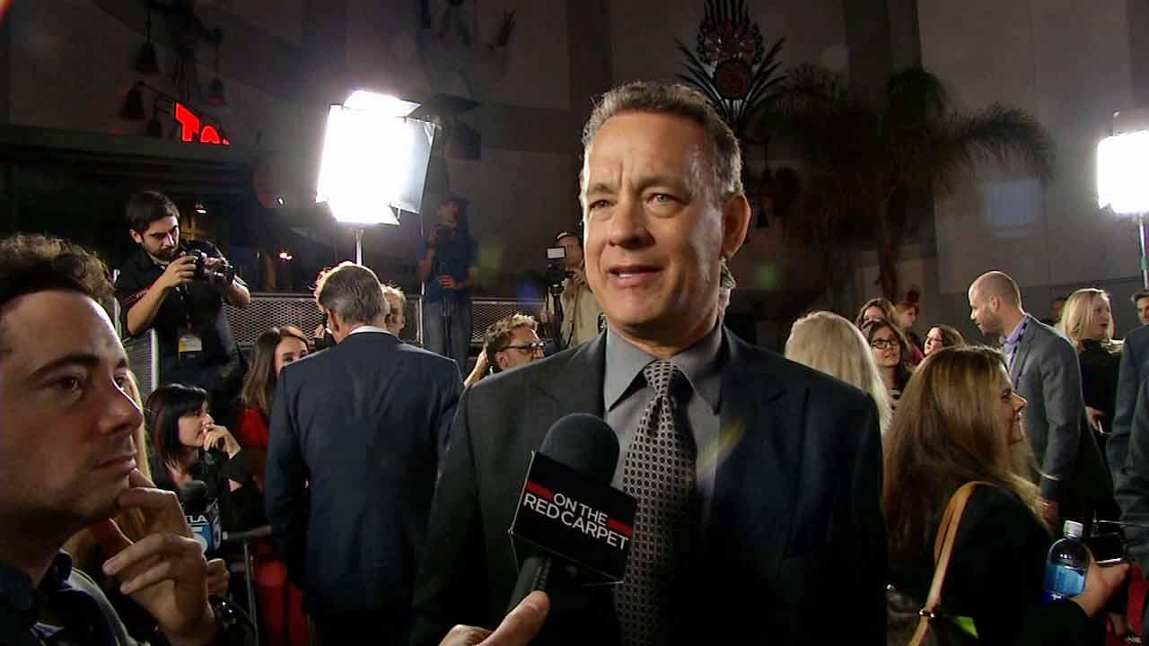 Tom Hanks appears at the Saving Mr. Banks screening in Los Angeles, California (November 2013).