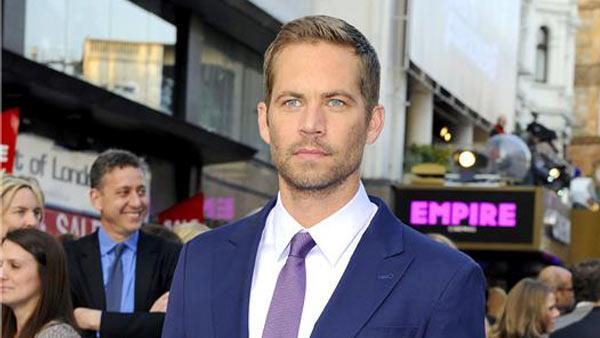 Paul Walker autopsy results were released on Wednesday, Dec. 4, 2013. In this photo, the actor appears at the London premiere of Fast and Furious 6 on May 7, 2013. - Provided courtesy of RICHARD YOUNG/REX/Startraksphoto.com