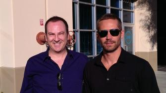 Paul Walkers autopsy results were released on Wednesday, Dec. 4, 2013. In this photo taken about a half-hour before Walker died in a car crash, the actor poses with friend Bill Townsend at a charity event in Valencia.
