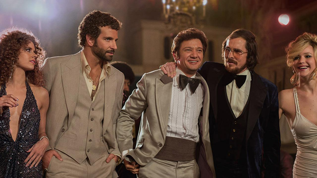 Amy Adams, Bradley Cooper, Jeremy Renner, Christian Bale and Jennifer Lawrence appear in a scene from the 2013 movie American Hustle.