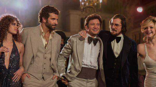 Amy Adams, Bradley Cooper, Jeremy Renner, Christian Bale and Jennifer Lawrence appear in a scene from the 2013 movie American Hustle. - Provided courtesy of Sony Pictures