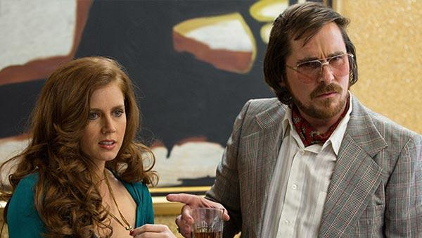Amy Adams and Christian Bale appear in a scene from the 2013 movie American Hustle. - Provided courtesy of Sony Pictures