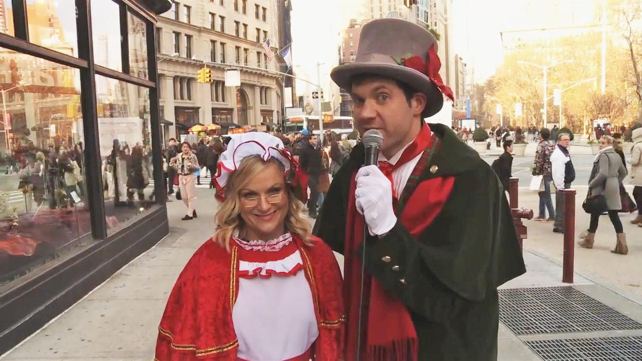 Amy Poehler and Billy Eichner appear in a skit which aired on Jimmy Kimmel Live on Dec. 11, 2013.