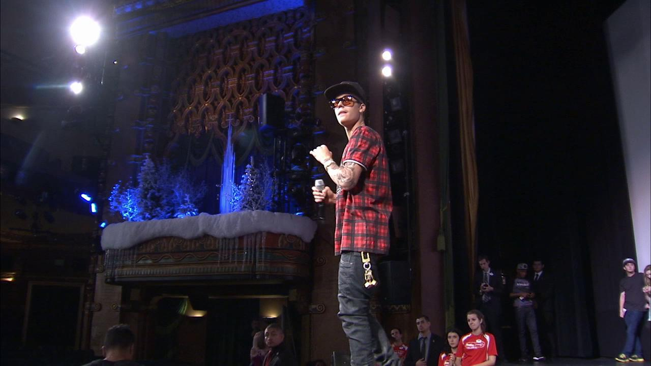 Justin Bieber hands out toys to fans at a screening of his new movie Believe on Dec. 16, 2013.