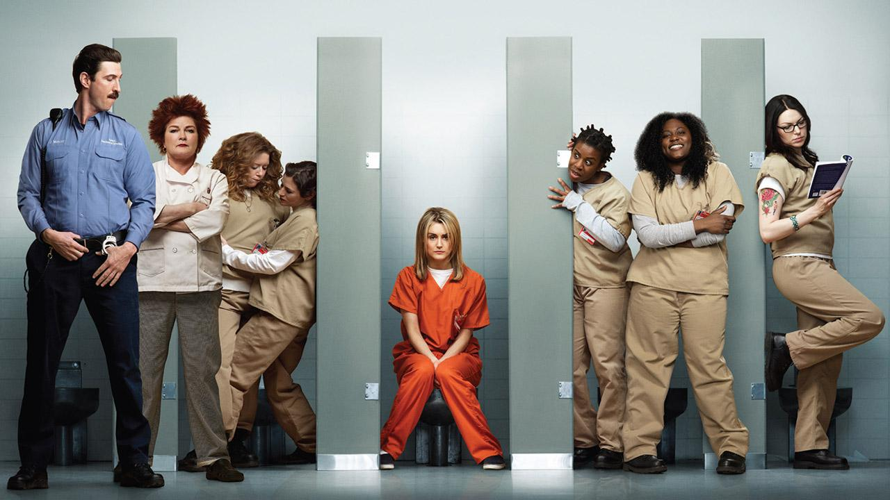 The cast of the Netflix series Orange Is the New Black appear in a promotional photo for the shows first season in 2013.