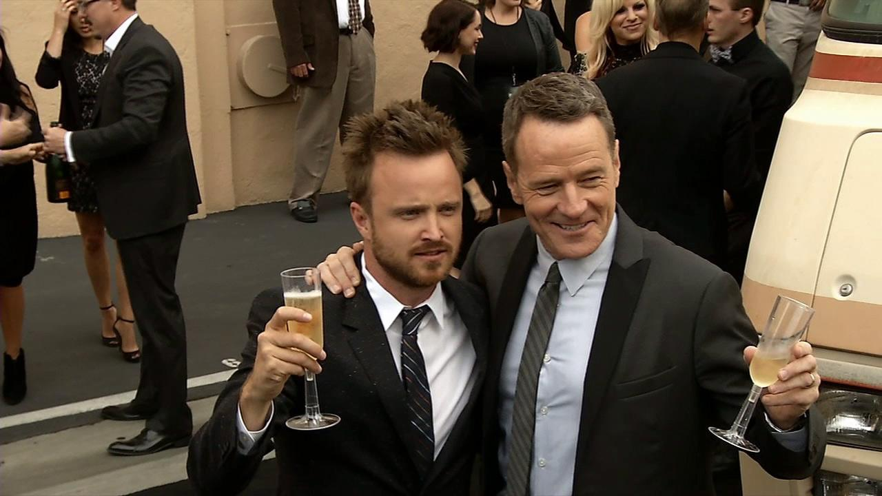 Breaking Bad stars Aaron Paul (Jesse Pinkman) and Bryan Cranston (Walter White) raise a champagne toast at an Los Angeles event celebrating the fifth and final season of the AMC show on July 24, 2013. The finale airs on Sept. 29.