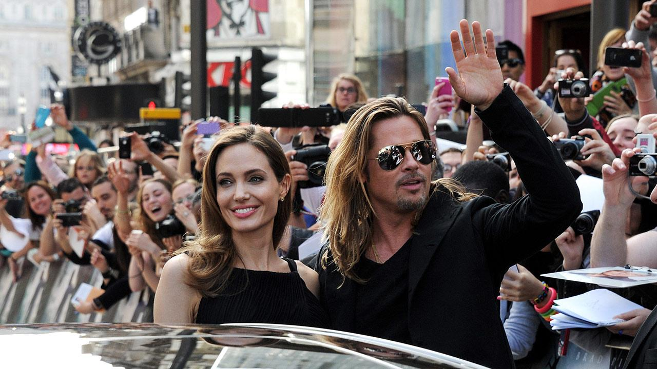Angelina Jolie (L) and Brad Pitt attend the World Premiere of World War Z at The Empire Cinema Leicester Square on June 2, 2013 in London. It marked Jolies first public appearance since she revealed in May that she had undergone a double mastectomy. <span class=meta>(Dave M. Benett &#47; WireImage for Paramount)</span>