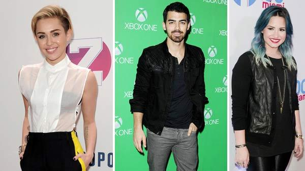 Miley Cyrus appears at Z100 Jingle Ball 2013 in New York City on Dec. 13, 2013. Joe Jonas appears at the L.A. Xbox One Launch on Nov. 21, 2013. Demi Lovato appears at Y100 Jingle Ball in Sunrise, Florida on Dec. 20, 2013. - Provided courtesy of Bill Davila / Daniel Robertson / Paul Emmans / startraksphoto.com