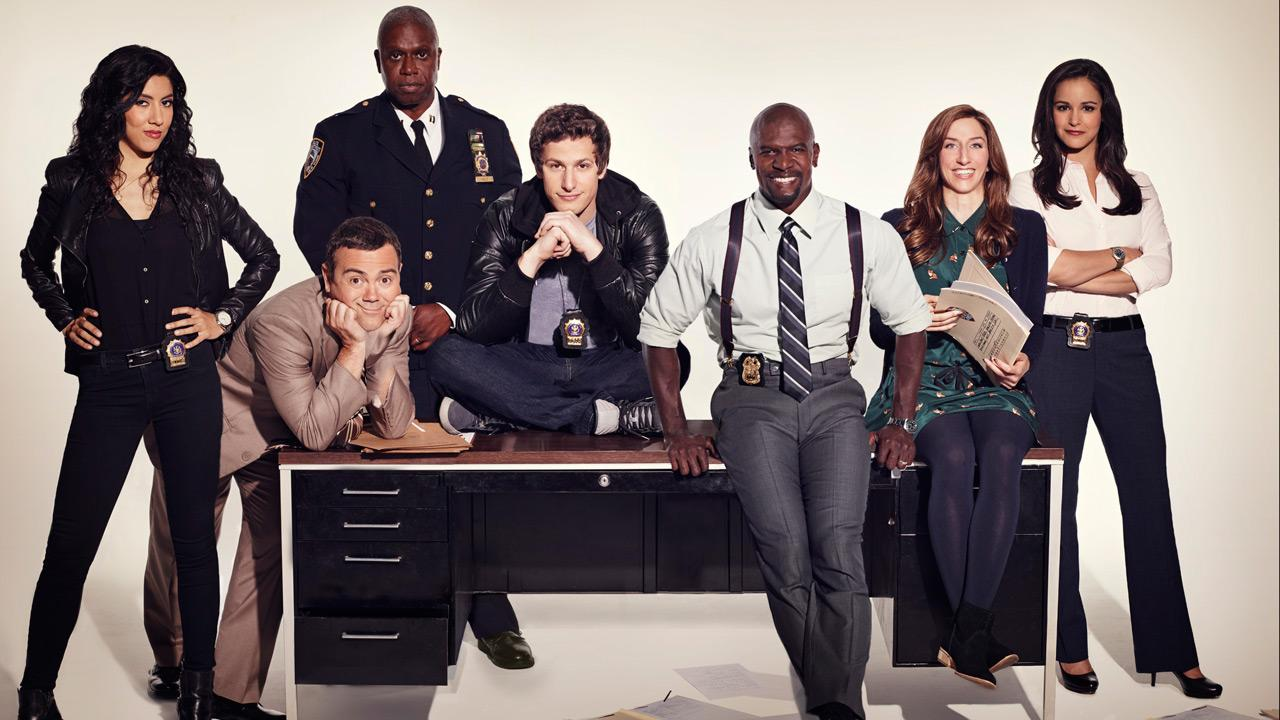 L-R: Stephanie Beatriz, Joe Lo Truglio, Andre Braugher, Andy Samberg, Terry Crews, Chelsea Peretti and Melissa Fumero appear in a promotional photo for the show Brooklyn Nine-Nine in 2013.