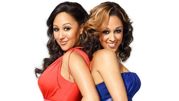 Tamara Mowry-Housley and Tia Mowry-Hardrict appear in a promotional photo for the third season of Tia and Tamera in 2013. - Provided courtesy of Matthias Clamer/E! Entertainment