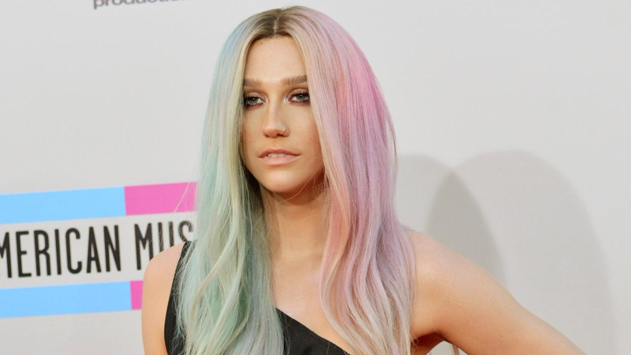 Kesha appears on the red carpet of the American Music Awards on Nov. 24, 2013.