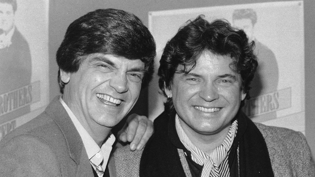 Phil and Don Everly, left to right, of the Everly Brothers joke around for photographers on Jan. 3, 1984 in New York City. Phil died on Friday, Jan. 3, 2014. <span class=meta>(AP Photo &#47; Ray Stubblebine)</span>