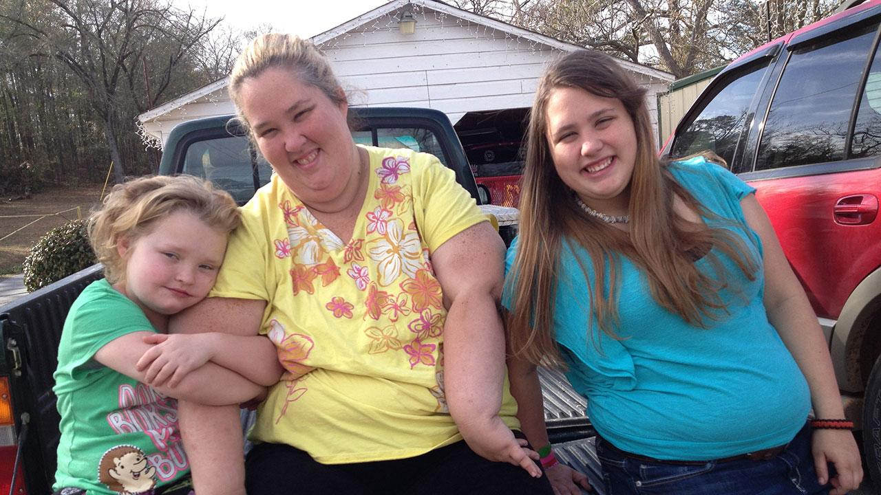 Honey Boo Boo (Alana Thompson), Mama June Shannon, and Chubbs (Jessica Shannon) sit on a pickup truck bed in a promotional photo for season 3 of TLCs Here Comes Honey Boo Boo. The family was in a car accident on Jan. 6, 2014.