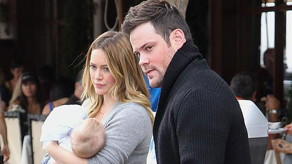 Hilary Duff, carrying baby Luca, and husband Mike Comrie appear in Los Angeles on Oct. 20, 2012. It was announced on Jan. 10, 2014 that the couple had split. - Provided courtesy of Norman Scott / Startraksphoto.com