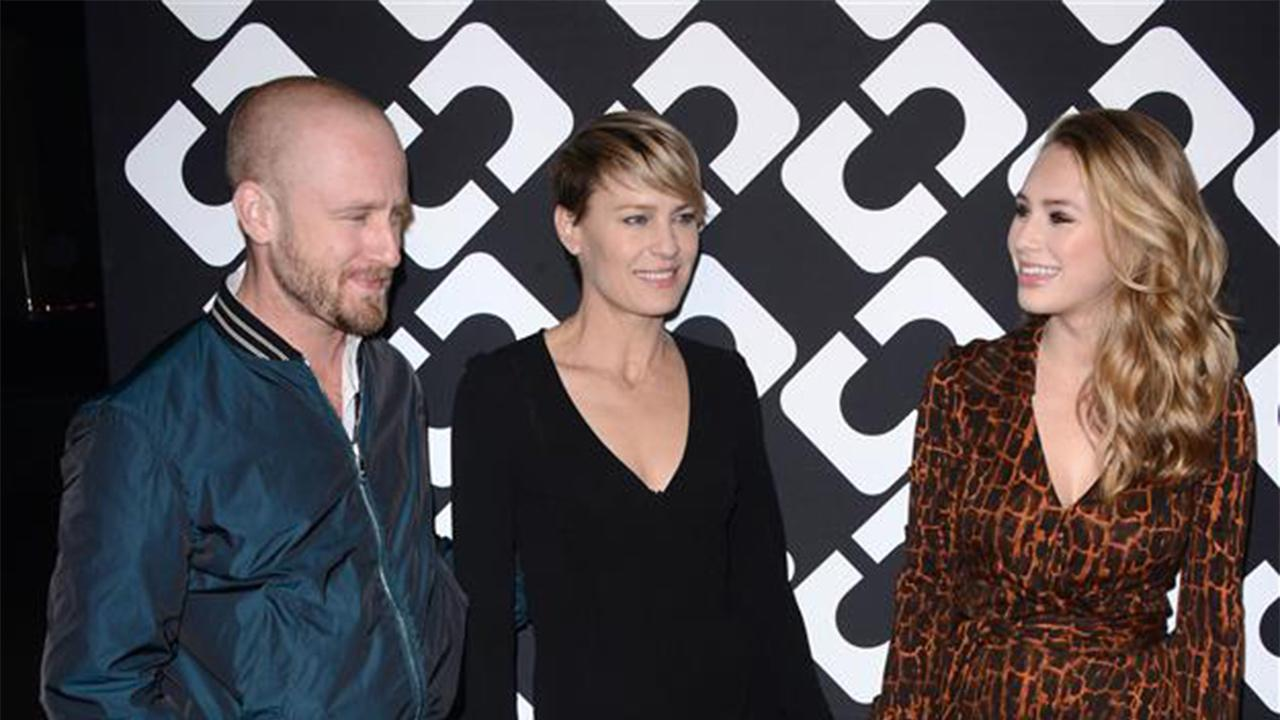 Ben Foster, Robin Wright and her daughter Dylan Penn appear at  Diane Von Furstenbergs Journey of a Dress Exhibition Opening event in Los Angeles on Jan. 10, 2014. It was reported that day that Wright and Foster are engaged.
