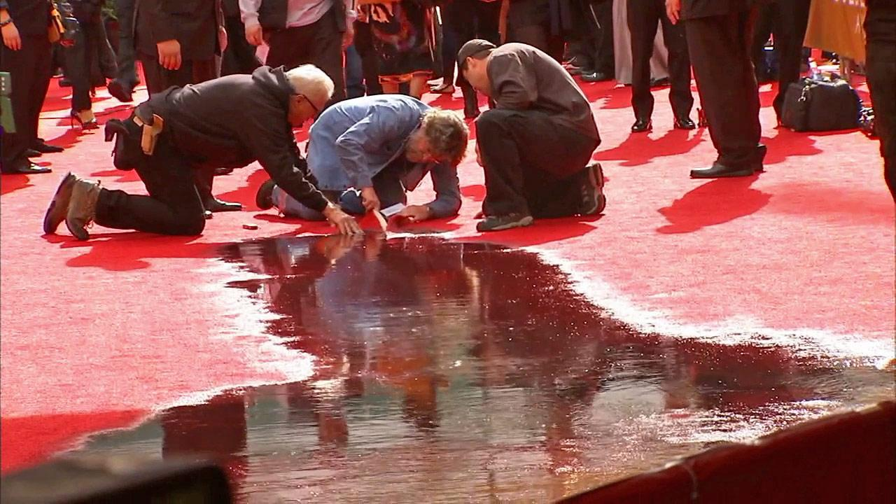 The 2014 Golden Glob red carpet was flooded after a light set off sprinklers. Witnesses reported a smell of sewage.
