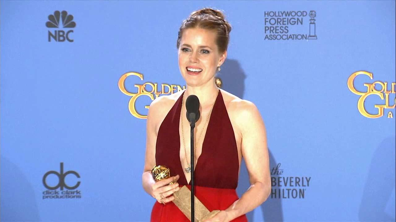 Amy Adams talks after winning an award at the 2014 Golden Globe Awards in Beverly Hills, California on Sunday, Jan. 12.