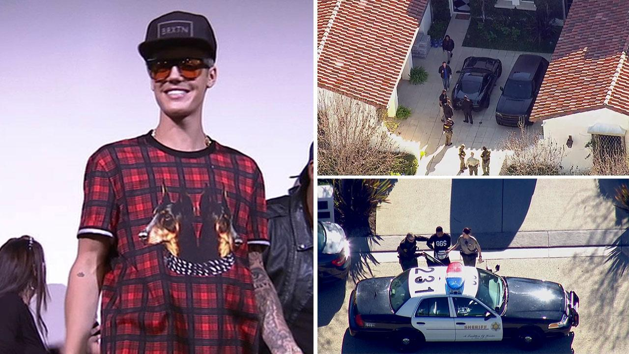 Justin Bieber appears at a Believe screening on Dec. 16, 2013. / Justin Biebers home in Calabasas, CA, was raided by police amid an egging investigation on Jan. 14, 2014. A man inside was arrested for drug possession after officers searched the house.