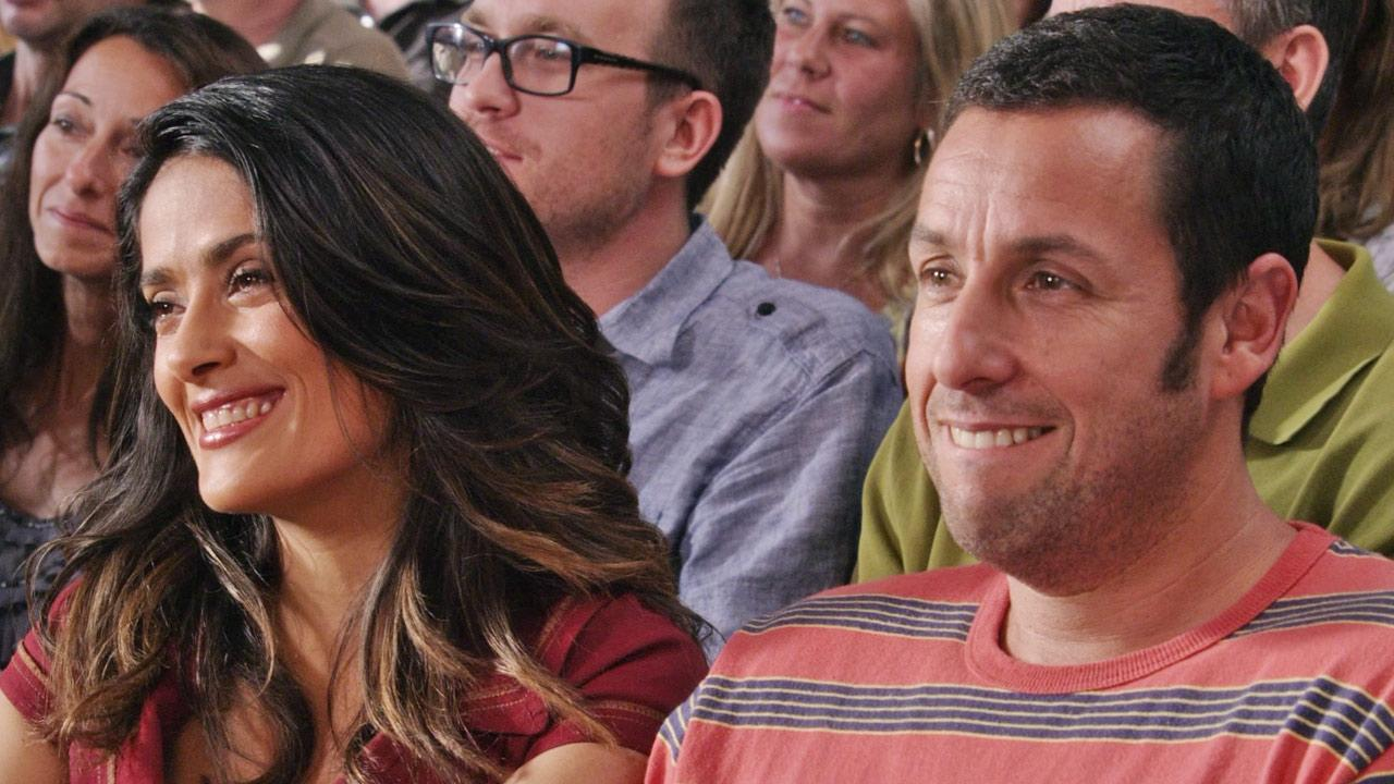 Adam Sandler, Salma Hayek appear in a scene from the 2013 film Grown-Ups 2.