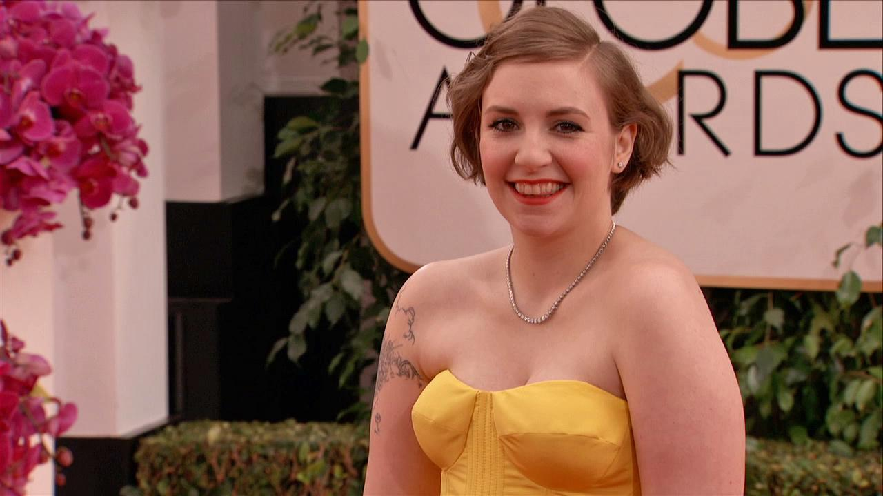 Girls creator and actress Lena Dunham poses on the red carpet at the 2014 Golden Globe Awards in Beverly Hills, California on Sunday, Jan. 12, 2014.