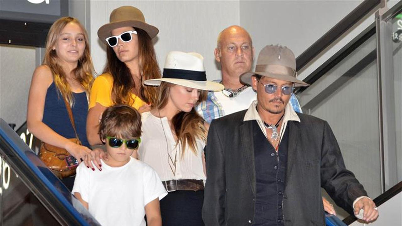 Johnny Depp is seen with girlfriend Amber Heard and his daughter Lily-Rose and son Jack, from a previous relationship, at Tokyo Airport on July 18, 2014. People magazine reported on Jan. 17, 2014 that Depp and Heard are engaged. <span class=meta>(Future Image &#47; Startraksphoto.com)</span>