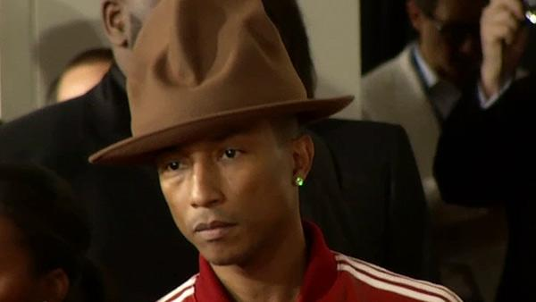 Pharrell, wearing a Vivienne Westwood hat, walks the red carpet at the 2014 Grammys on Jan. 26, 2014. - Provided courtesy of OTRC