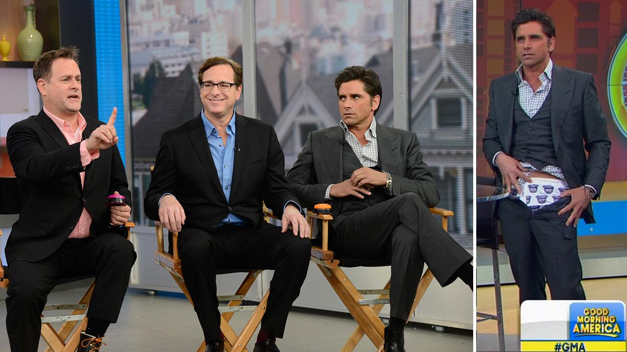 John Stamos reveals Oikos Greek yogurt underwear on ABCs GMA on Jan. 29, 2014 during a Full House reunion with Dave Coulier and Bob Saget. They promoted an ad for the brand that stars the three of them and is set to air during the 2014 Super Bowl.